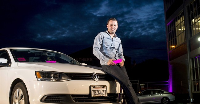 Lyft cars still think pink, but streamline the 'stache