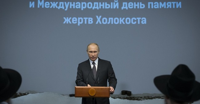 Putin marks Auschwitz liberation to press points on Ukraine