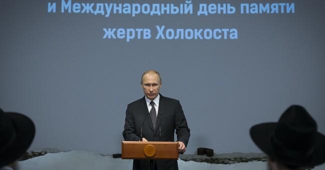 Putin marks Auschwitz liberation to press points on Ukraine