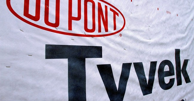 DuPont profit rises, but strong dollar cuts into sales