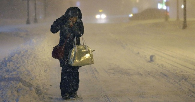 AP PHOTOS: Snowstorm pounds Northeast _ most of it, anyway