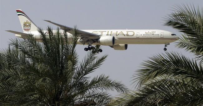 Airlines halt flights to Baghdad after gunfire hits plane