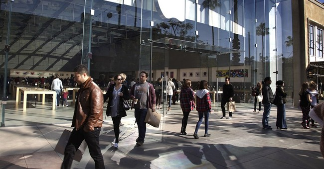 Record iPhone sales drive blowout quarter for Apple