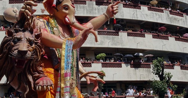 AP PHOTOS: Devout Hindus celebrate the birth of god Ganesha