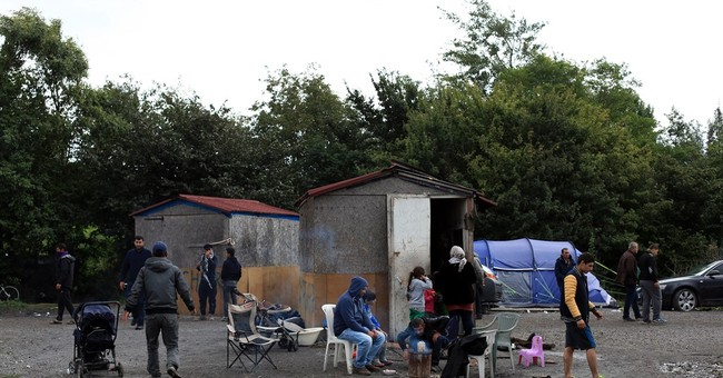 Hope, fear, waiting at French migrant camps run by smugglers