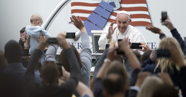 Pope uses popularity to chart new direction for church & US