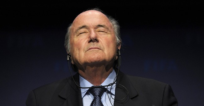 Sepp Blatter tells FIFA staff he has done nothing illegal
