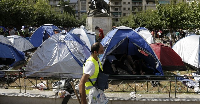 The Latest: Overcrowding in refugee housing now an issue