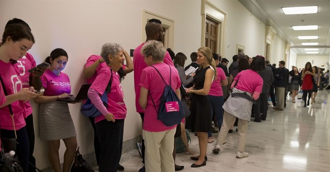Facing Congress, Planned Parenthood chief rebuts videos