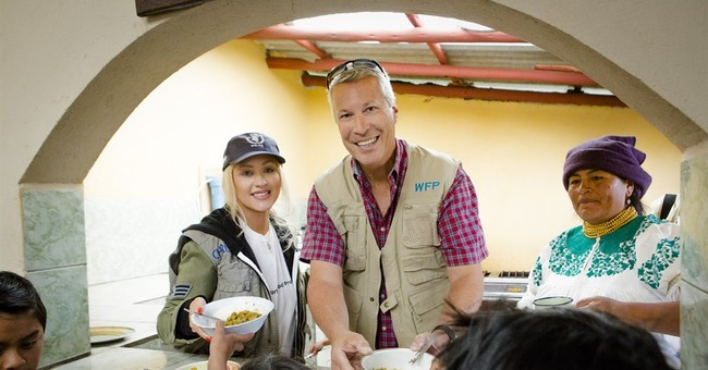 Aguilera connects with roots on Ecuador hunger relief trip