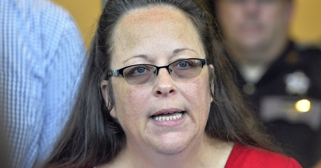 Clerk who rejected licenses for gays says she met with pope