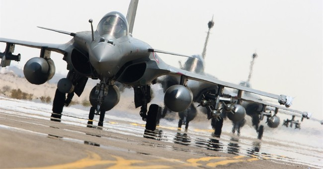 First French airstrikes in Syria killed 30 at IS camp