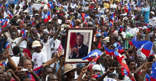 In Haiti, Aristide tells thousands to vote for candidate