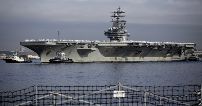 Nuclear-powered carrier USS Ronald Reagan arrives in Japan