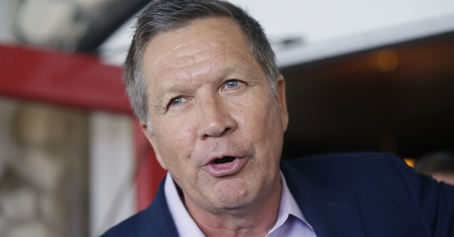Kasich touts record _ and dance skills _ in Iowa