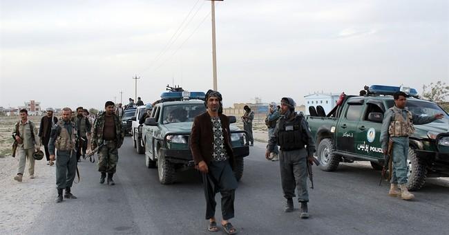 US airstrikes back Afghan push to retake city from Taliban