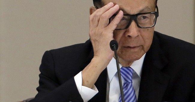Asia tycoon Li on defensive after attacks from Chinese media