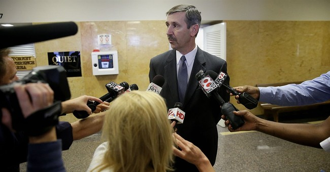 Oklahoma sheriff indicted in shooting probe to resign