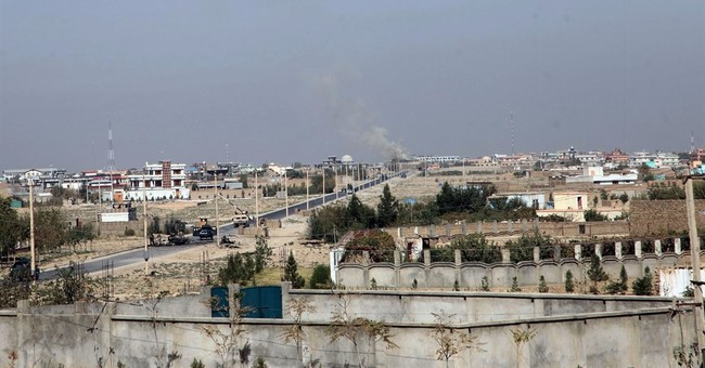 The Latest: Afghan president says Kunduz fully recaptured