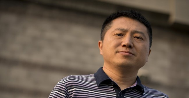 China journalist refuses to confess despite police pressure