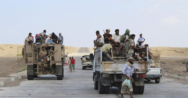 Yemen officials say rebels trading fire with coalition ships