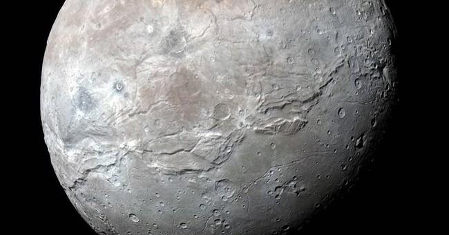 NASA releases best photos yet of Pluto's jumbo moon, Charon