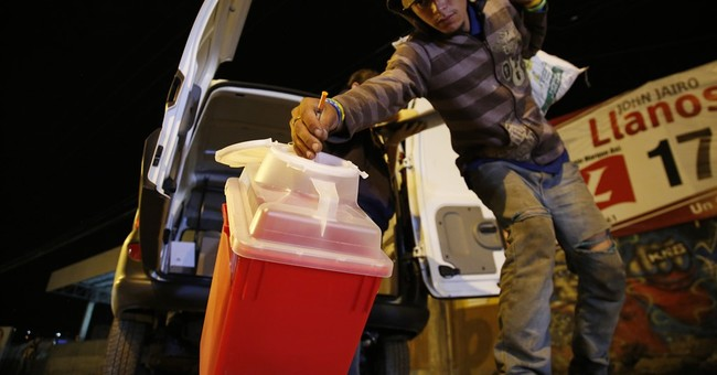AP PHOTOS:  Clean needles provided to Colombia heroin users