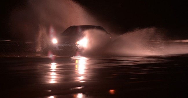 Rains drench saturated East Coast; woman drowns in vehicle