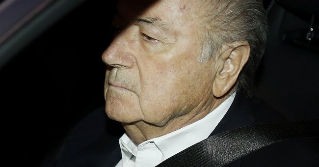 Blatter defies calls from FIFA sponsors to quit immediately