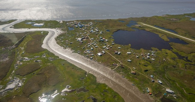 Alaska officials eye eroding village as relocation model