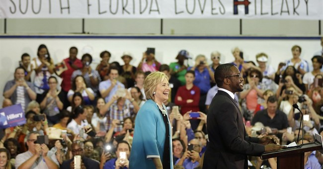 Clinton pledges to fight NRA on gun rights after shooting