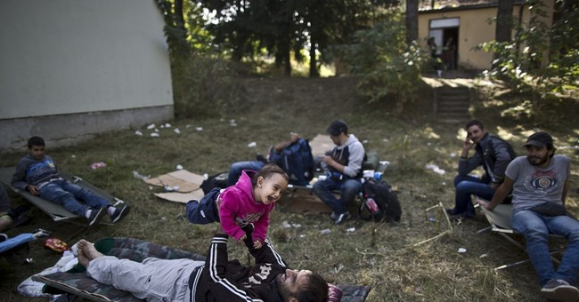 AP PHOTOS: Children find simple joys along migrant trail
