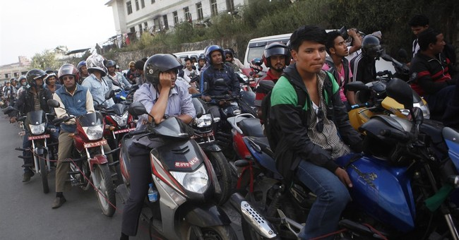 Nepalis adapt to fuel shortage by carpooling, riding bikes