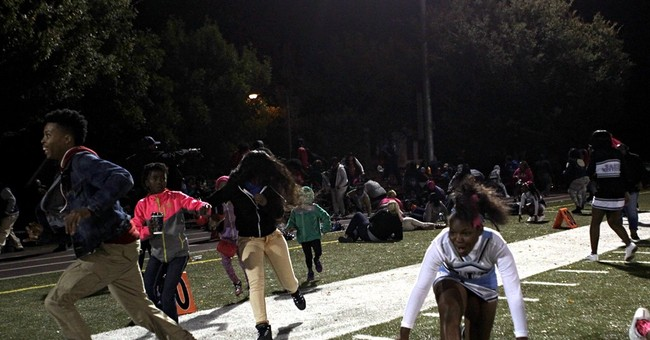 St. Louis high school football game interrupted by gunshots
