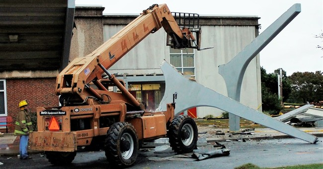 Official: 25 hurt in collapse of concrete awning at school