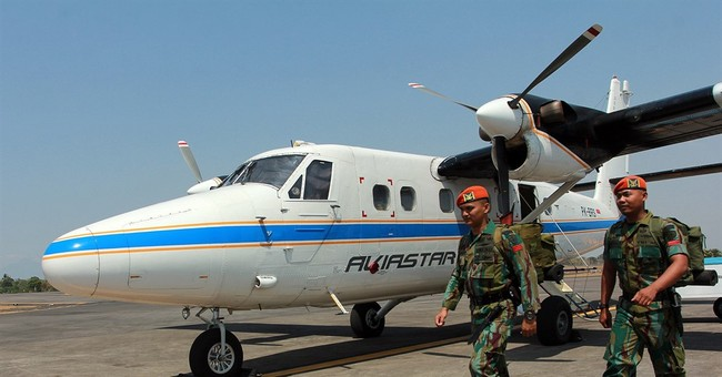 Weather hinders search for missing small Indonesian plane