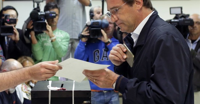 Portugal government re-elected despite painful austerity