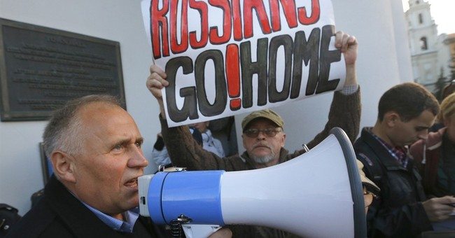 Belarusian protesters decry planned Russian air base