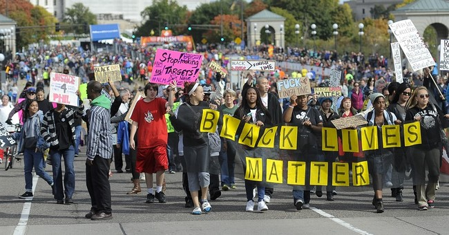 Black Lives hold peaceful protest at Twin Cities Marathon