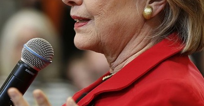 Clinton slams Benghazi committee in TV interview, ad
