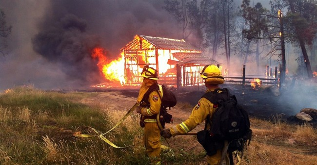 Report details ordeal of 4 firefighters trapped by blaze