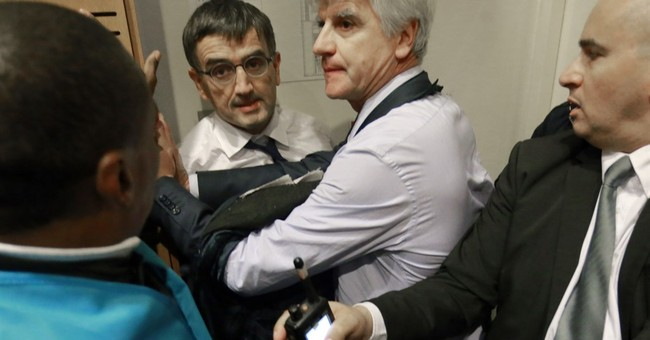 Workers tear shirts off Air France managers in jobs protest