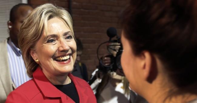 Clinton slams Benghazi committee in TV interview, ad