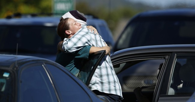 The Latest: Obama to visit Oregon shooting victims' families