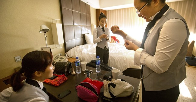 White-gloved butlers a new must-have for China's super-rich