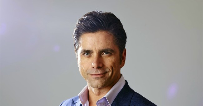 John Stamos surrenders to being charming in 'Grandfathered'