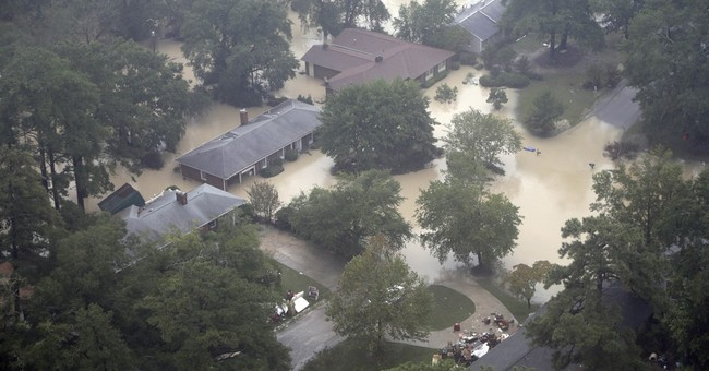 AP PHOTOS: Gills Creek gets one of rainiest days in years