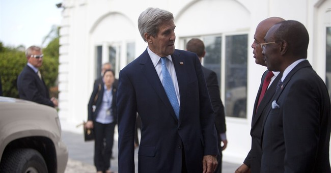 Kerry stops in Haiti to discuss election preparations