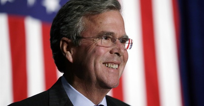 Bush touts upbeat vision with Iowa speech and new video