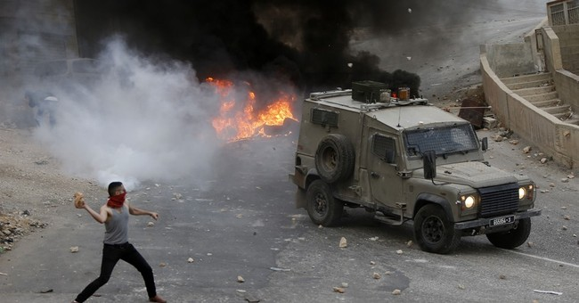 After weeks of unrest, Palestinian leader appeals for calm